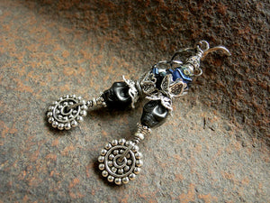 Dia de los Muertos style sugar skull earrings with black magnesite skulls, deep blue flowers & lots of silver details.