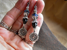 Load image into Gallery viewer, Elegant black & silver sugar skull earrings with magnesite skulls, deep blue flowers & lots of silver details.