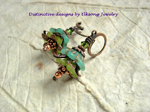 Dainty Summer Grass earrings with green glass & resin flowers, copper caps & beads and Swarovski crystals.