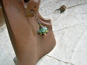 Green & copper earrings with glass & resin flowers, copper caps & beads and Swarovski crystals.