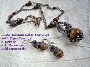Lush, autumn color earrings & necklace  with faceted tiger eye & black tourmaline and oxidized copper wire wrap.