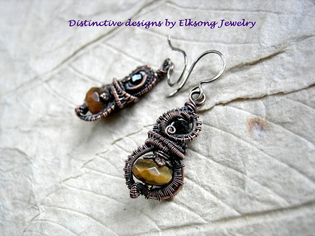 Lush, autumn color earrings with faceted tiger eye & black tourmaline and oxidized copper wire wrap.