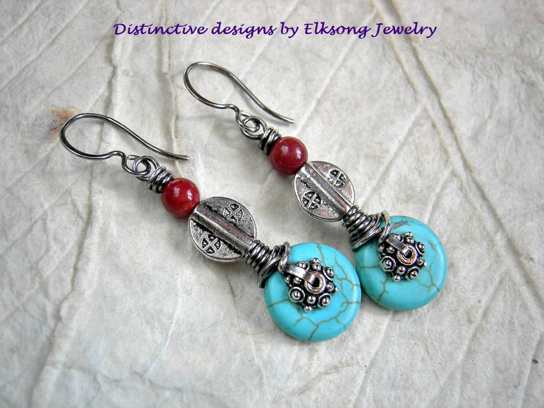 Exotic boho earrings with turquoise colored magnesite, vintage coral & silver Thai & Tibetan style beads.