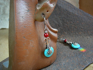 Boho luxe earrings with turquoise colored magnesite, vintage coral & silver Thai & Tibetan style beads.