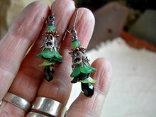 Load image into Gallery viewer, Elegant flower drop earrings with resin flowers & crystal teardrops in green, black & antiqued copper. Sophisticated faery couture.