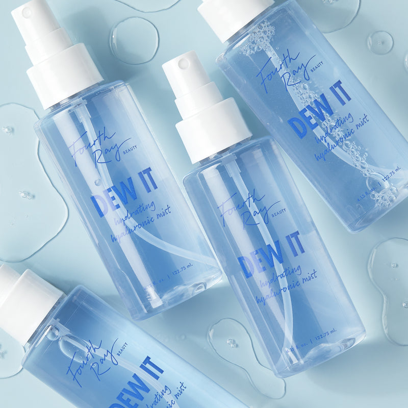 DEW-IT Hydrating Hyaluronic Mist bottles with droplets of water