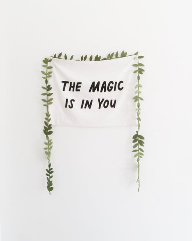 Words on a wall saying the magic is in you.