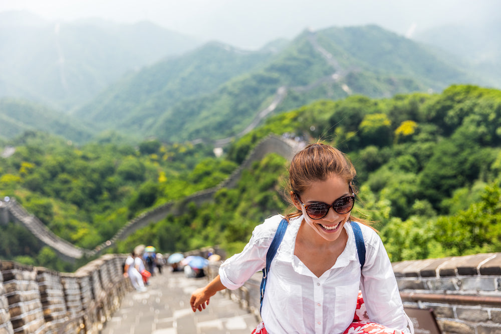 woman climbing great wall of china