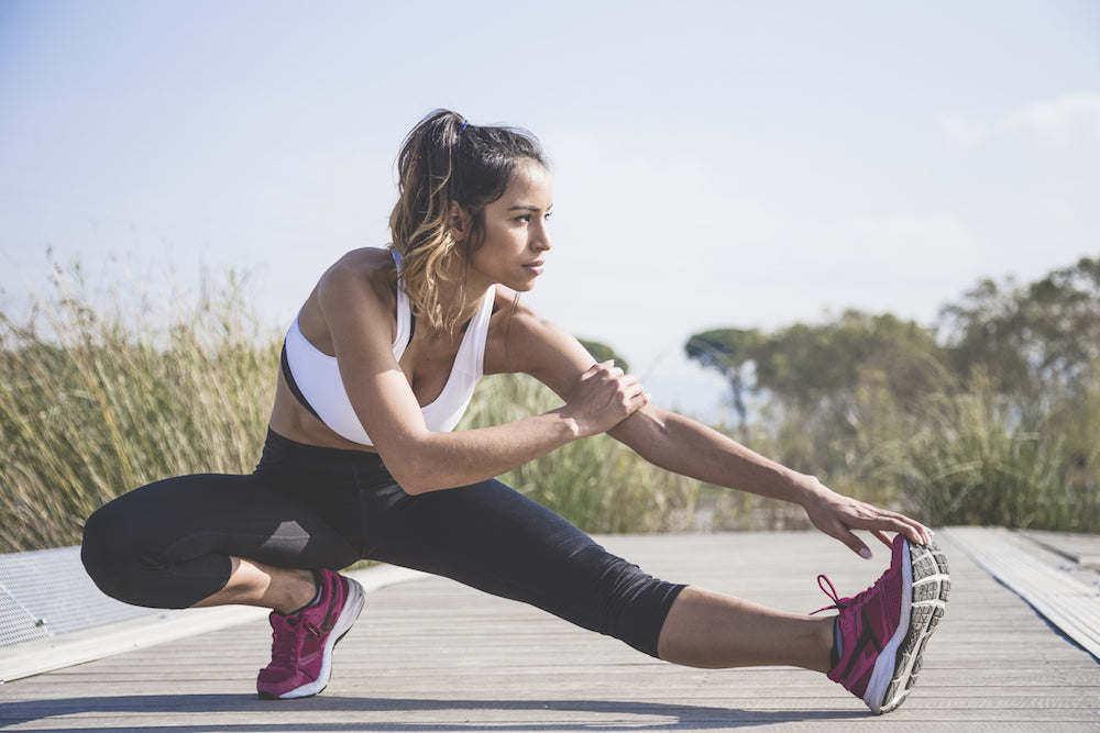 woman stretching during run