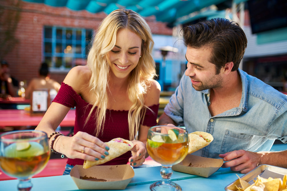 couple eating tacos at a restaurant