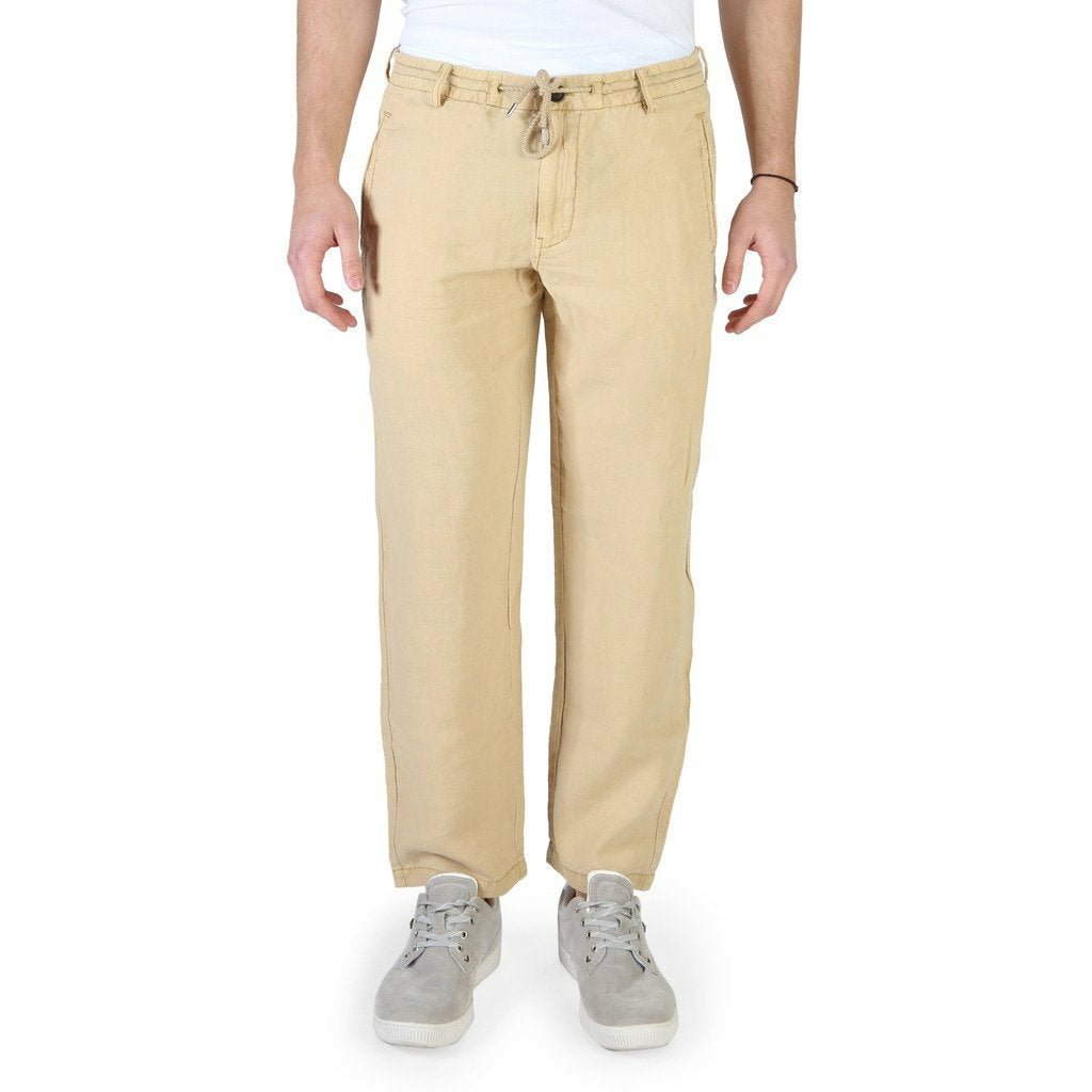 Brown button and zip fastened trousers with four pockets and logo details