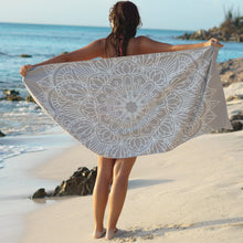 Load image into Gallery viewer, woman standing on shore with arms outstretched holding grey towel with mandala print