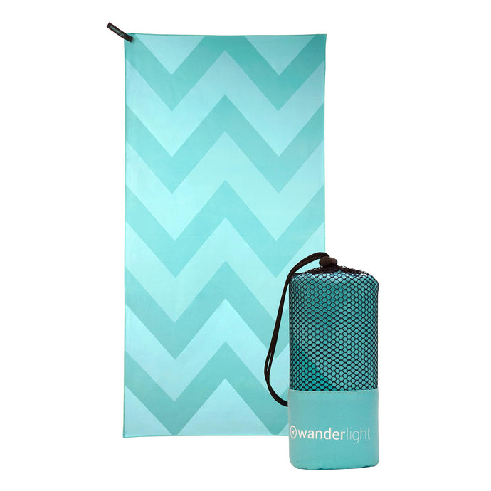 turquoise towel with darker turquoise chevron print, hang loop on upper left corner and branded turquoise carrying pouch
