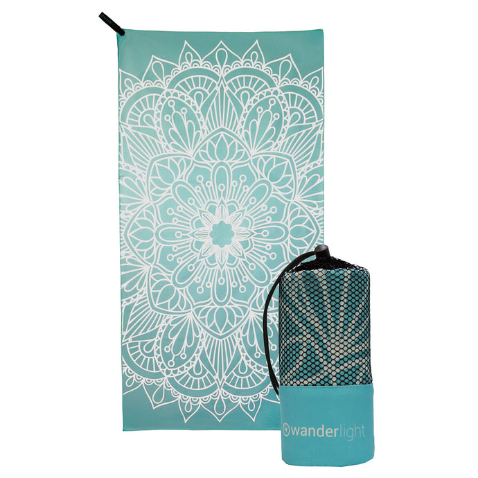 turquoise towel with large white mandala print, hang loop on upper left corner and branded turquoise carrying pouch