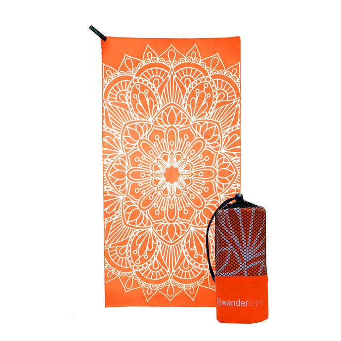 orange towel with large white mandala print, hang loop on upper left corner and branded orange carrying pouch