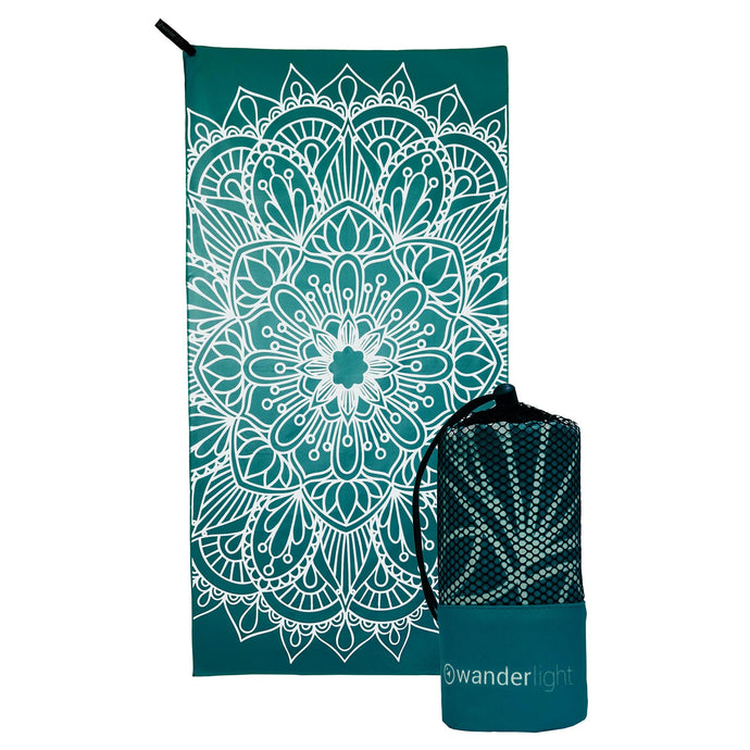 teal towel with large white mandala print, hang loop on upper left corner and branded teal carrying pouch