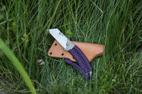 Banzelcroft Customs MEK, a titanium EDC utility knife with acid purple paracord wrapped handle.