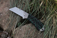 Banzelcroft Customs MEK, a titanium EDC utility knife with black with Kelly green X paracord wrapped handle.