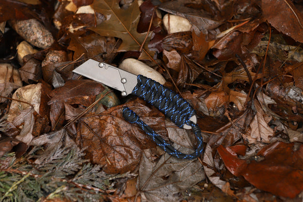 Banzelcroft Customs MEK, a titanium EDC utility knife with force paracord wrapped handle.