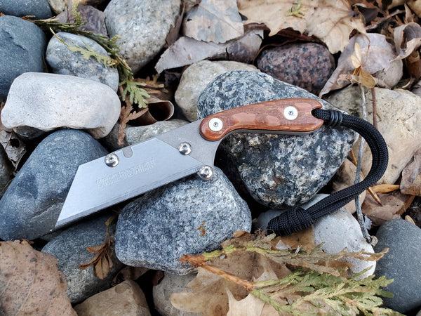 Banzelcroft Customs Mini MEK, a titanium EDC utility knife with leopardwood and black liner handle.