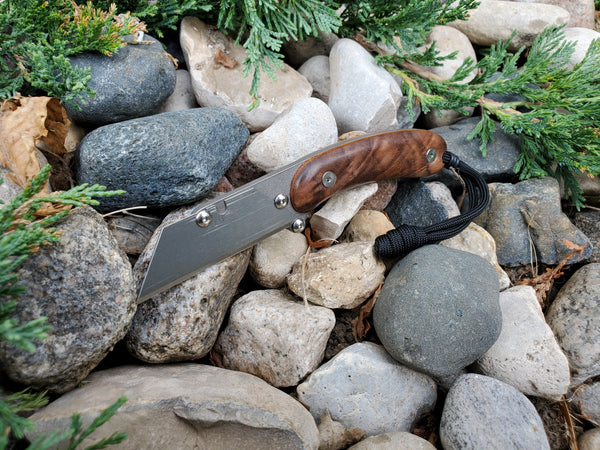 Banzelcroft Customs MEK, a titanium EDC utility knife with a figured walnut with natural micarta liner handle.