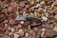 Banzelcroft Customs MEK, a titanium EDC utility knife with a milled black and grey G10 handle.