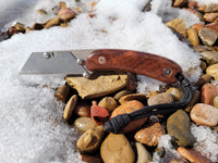 Banzelcroft Customs MEK, a custom titanium EDC utility knife with crosscut ringed gidgee scales.