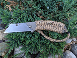 Banzelcroft Customs MEK, a titanium EDC utility knife with desert camo paracord wrapped handle.