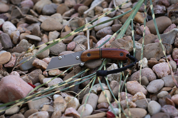 Banzelcroft Customs MEK, a titanium EDC utility knife with Honduran rosewood and vintage crosscut linen micarta handle scales.