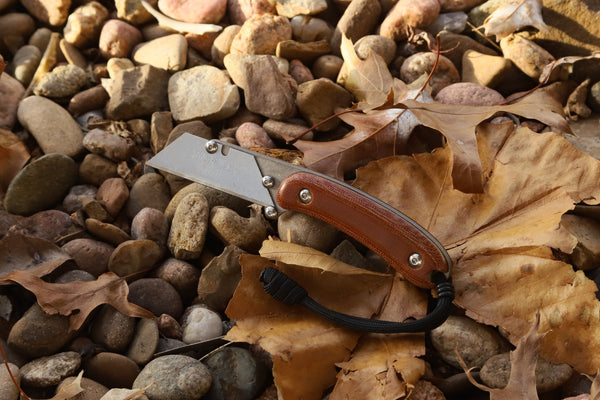 Banzelcroft Customs MEK, a titanium EDC utility knife with natural canvas micarta and black liner handle scales.