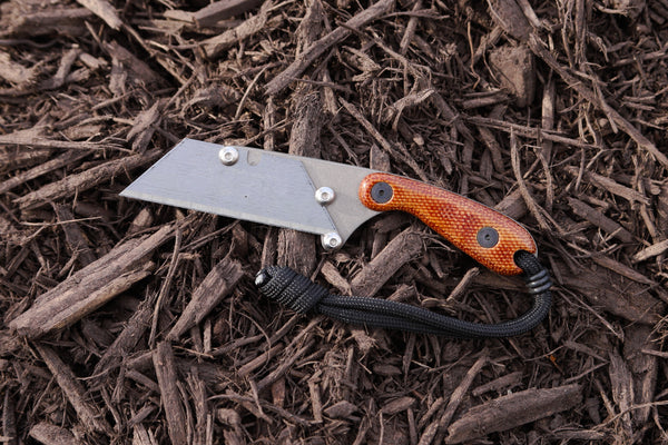 Banzelcroft Customs Mini MEK, titanium EDC utility knife with vintage canvas micarta handle.