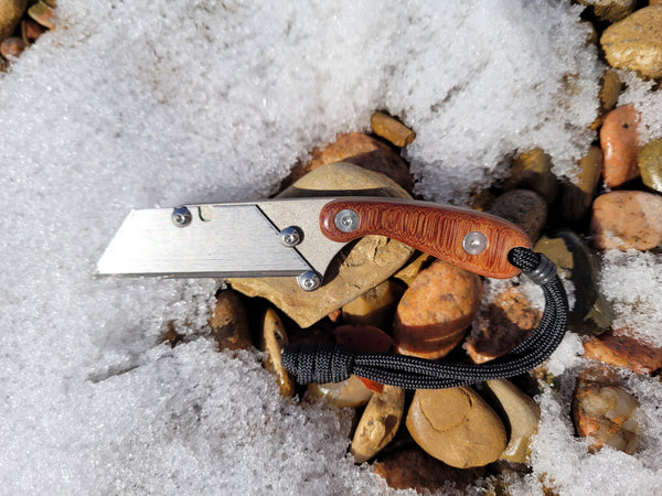 Banzelcroft Customs mini MEK, a custom titanium EDC utility knife with crosscut vintage linen micarta handle scales.