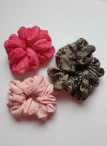 3 scrunchies, hot pink, light pink and animal print