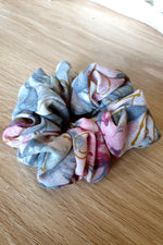 one multicoloured, grey and pink scrunchie