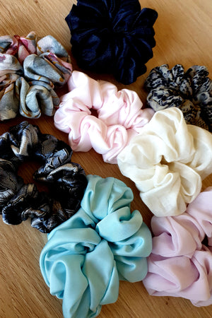 mixed pile of scrunchies in different colours