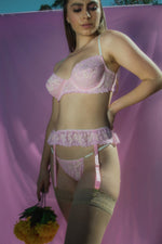 Pink lace garter skirt belt front