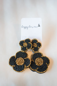 Black and gold flower earrings