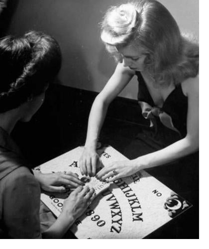 women using ouija board