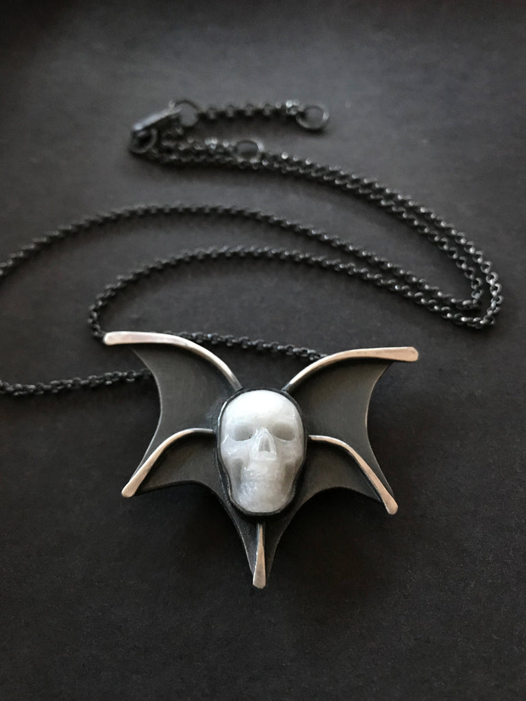 Quartz Skull with Bat Wings Pendant