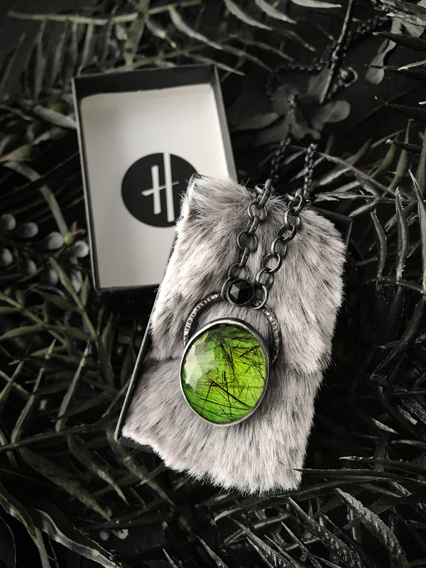 Crystal Ball Pendant with Glowing Green Rutilated Quartz