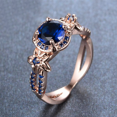 Luxxurio Blue Gem Rose Gold Wedding Ring