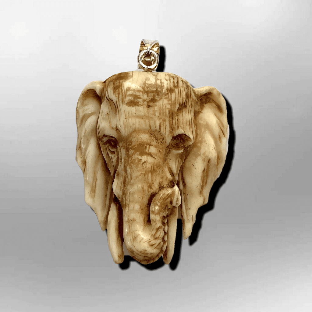 Handmade Bone Carved Elephant Head Shape Curved Back No Paint Detailed Pendant - Kachina City