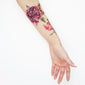 purple watercolor temporary tattoo forearm