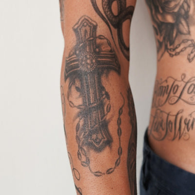 cross rosary tattoo