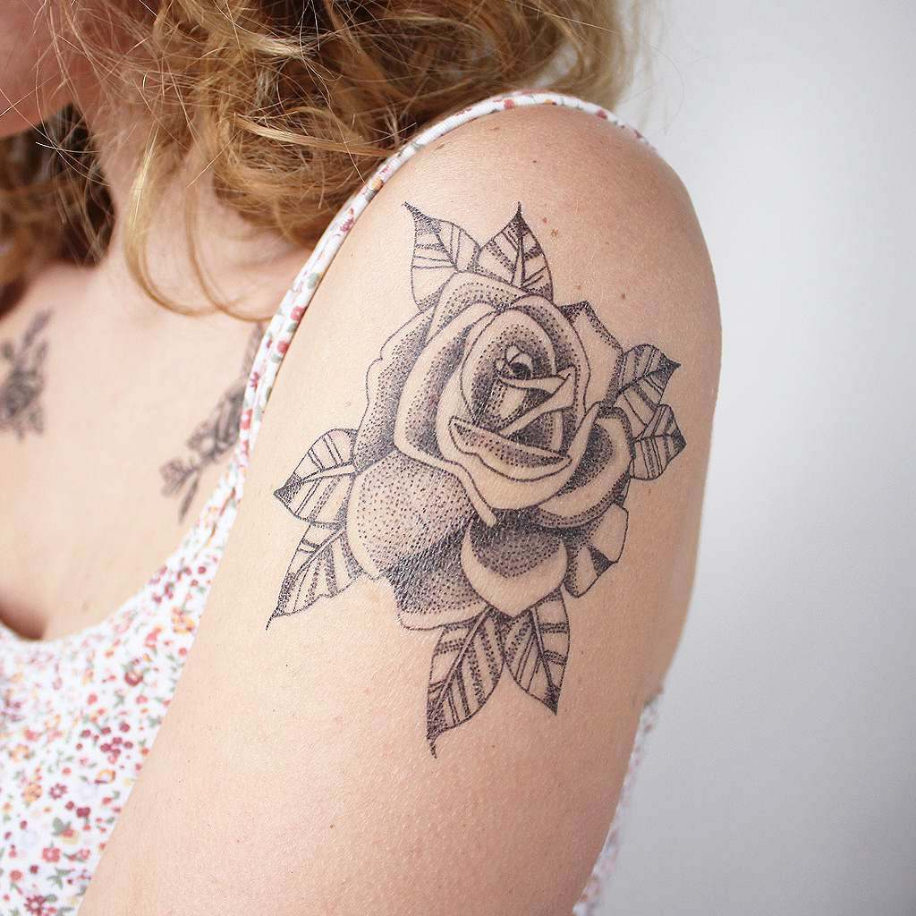 rose linework tattoo