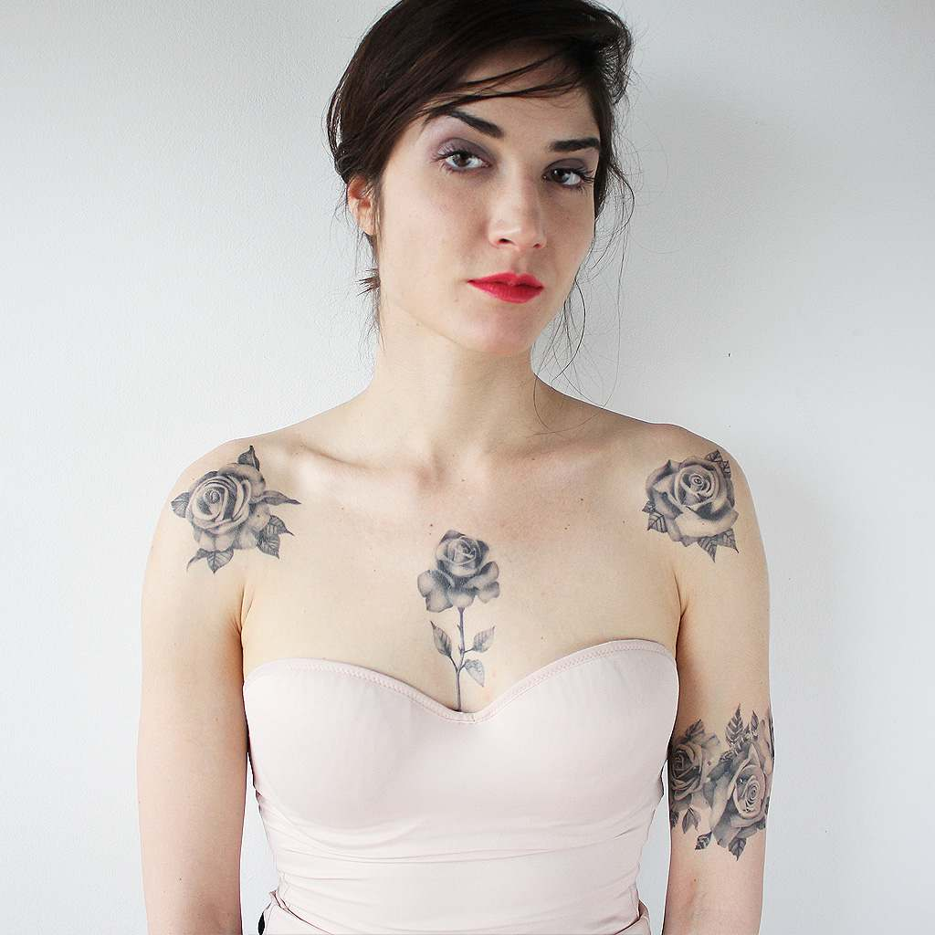 cute girl with rose tattoos