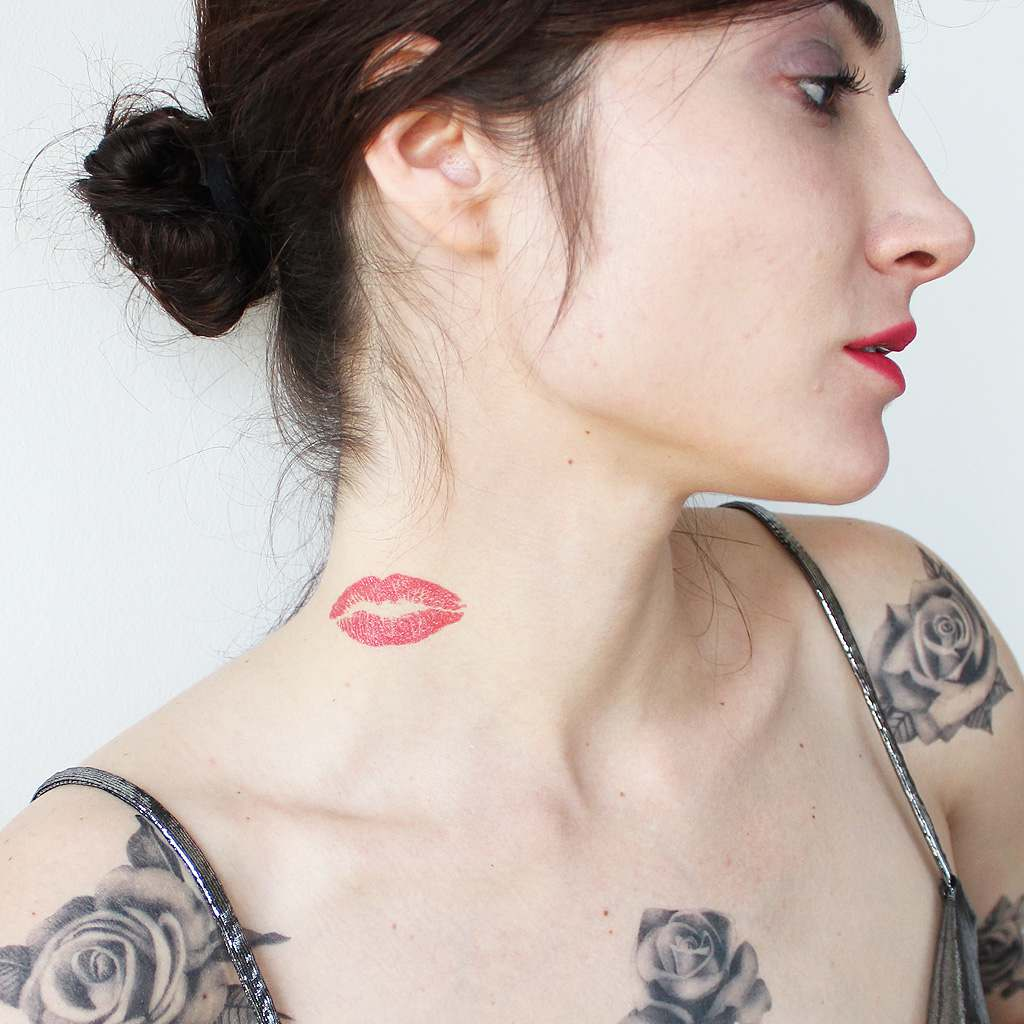 lips neck tattoo