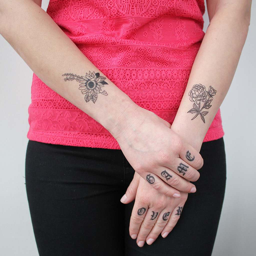 girl with temporary knuckle tattoos