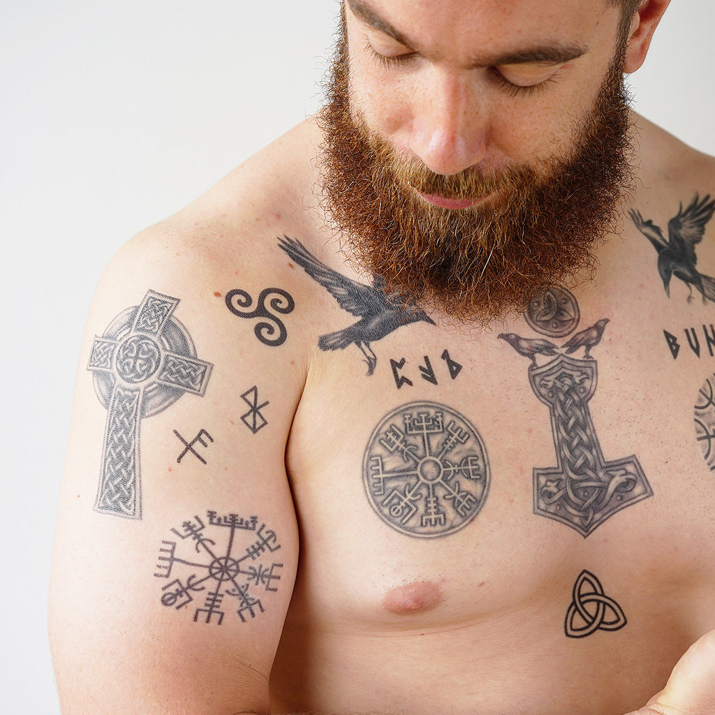 guy with norsk tattoos