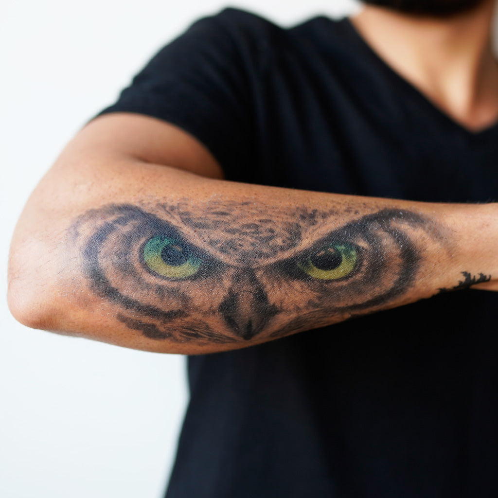 owl eyes forearm tattoo